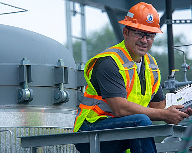 smiling worker in hard hat