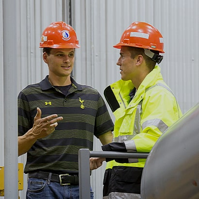 two workers discussing plans