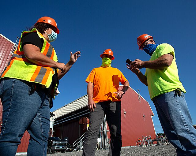 masked workers collaborating