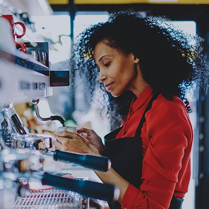 coffeeshop worker making latte