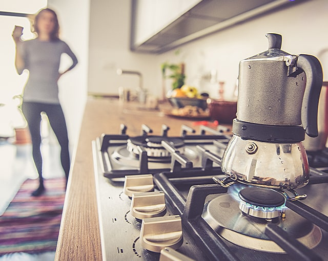 coffeemaker on gas stovetop