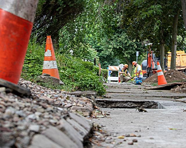 utility workers in residential neighborhood